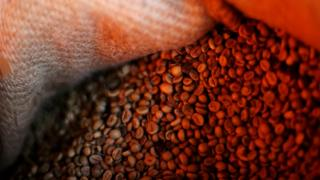 Coffee beans pictured inside a sack