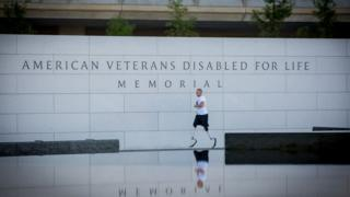 Rob Jones running around a disabled veterans memorial