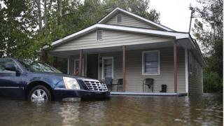 Flood waters surround a home after Hurricane Florence passed through the area