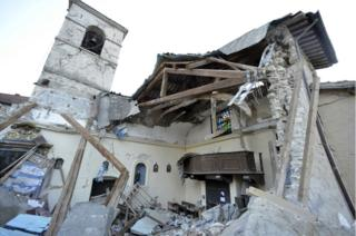 A view of a damaged church in the village of Visso, Italy, after a 5.9 earthquake destroyed part of the town.