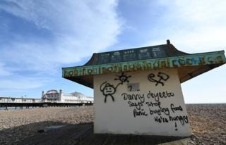 Graffiti on Brighton beach urging people to stop panic buying