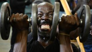 A man lifts weights as he works out at the Kaloleni gym, in Nairobi, Kenya - Wednesday 9 January 2019