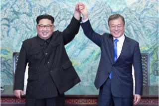 North Korean leader Kim Jong-Un (L) and South Korean President Moon Jae-In (R) join hands after signing a document at the Joint Security Area (JSA) on the Demilitarized Zone (DMZ) in the border village of Panmunjom in Paju, South Korea, 27 April 2018. South Korean President Moon Jae-in and North Korean leader Kim Jong-un are meeting at the Peace House in Panmunjom for an inter-Korean summit. The event marks the first time a North Korean leader has crossed the border into South Korea since the end of hostilities during the Korean War. EPA/KOREA SUMMIT PRESS / POOL