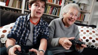 Grandmother and grandson playing computer game
