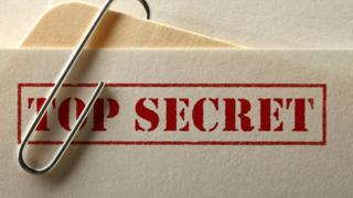 "A folder marked ""top secret"""