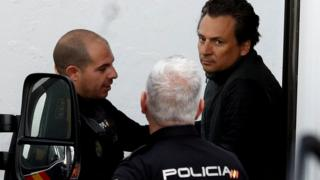 Former chief executive of Mexico's state oil firm Pemex, Emilio Lozoya, is escorted by Spanish police officers as he leaves a court in Marbella, Spain, 13 February 2020