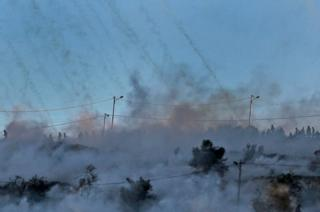 Tear gas smoke fired by Israeli troops during clashes with Palestinian protesters near an Israeli checkpoint in the West Bank city of Ramalla