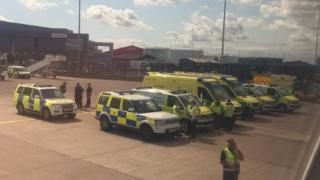 Police near plane at Manchester Airport
