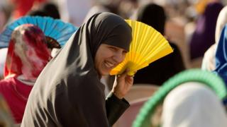 "Muslim women use fans while attending Eid al-Fitr prayers to mark the end of the holy fasting month of Ramadan, in Spain""s north african enclave Ceuta June 26, 2017."