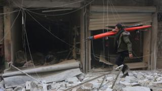 Bombed out windows in the aftermath of a reported air strike in the Syrian city of Aleppo