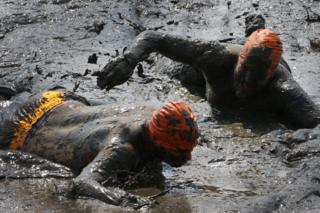 Competitors take part in the 2018 Mud Olympics in Brunsbüttel in northern Germany