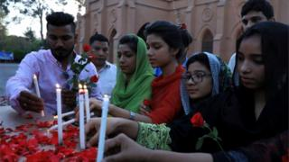 Sri Lankans light candles for victims of suicide bomb attacks in the country, April 2019