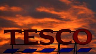 Red clouds over Tesco store