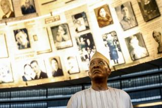 Chadian President Idriss Deby looks at pictures of Jewish Holocaust victims at the Hall of Names during his visit to the Yad Vashem Holocaust Memorial museum in Jerusalem, Israel - 26 November 2018
