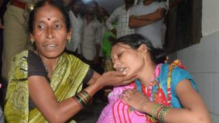 Relatives mourn the death of a children at Baba Raghav Das Hospital in Gorakhpur district of the Indian northern state Uttar Pradesh