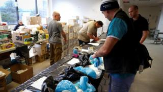 Nurses pick up personal protective equipment (PPE) and other supplies at a New York State emergency operations incident command centre