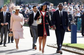Idris Elba and Sabrina Dhowre, followed by Oprah Winfrey, arrive at St George's Chapel