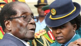 President Robert Mugabe leaves after delivering his State Of the Nation address at Parliament in Harare, Zimbabwe, December 6, 2016.