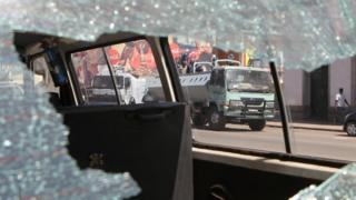 Riot police seen through a broken car window in Harare, Zimbabwe - Wednesday 3 August 2016