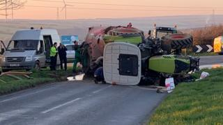 Tractor on its side