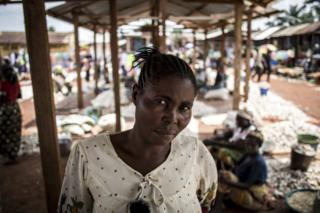 Portrait of Marie, who has had her name changed for protection, a market trader in Mangina, DRC