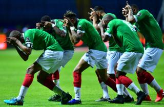 Madagascar's players celebrate their goal during the 2019 Africa Cup of Nations (CAN) football match between Guinea and Madagascar at Alexandria Stadium on June 22, 2019.