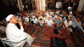 Tunisians listen to a lecture on Islam and tolerance at Zitouna Mosque in Tunis (file photo)