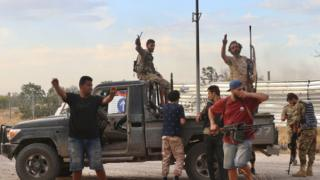 Members of Libyan army celebrate after recapturing Tripoli airport from warlord Khalifa Haftar's militias in Tripoli, Libya on June 03, 2020.