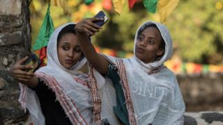 Women taking a selfie during the annual Timkat epiphany celebration in Gondar, Ethiopia - Wednesday 18 January 2017