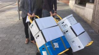 Cardoza case papers being delivered at the High Court in Birmingham.