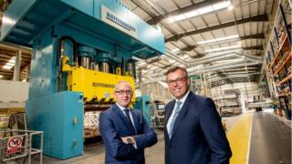 Jonathan Holmes (left), managing director of Creative Composites Ltd with Alastair Hamilton, chief executive officer of Invest NI