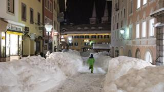 A boy runs through the snow-covered town centre of Berchtesgaden, Bavaria, Germany, 10 January 2019