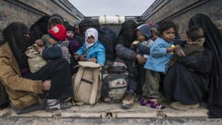 "Woman and children who fled the Islamic State (IS) group""s embattled holdout of Baghouz on February 14, 2019"