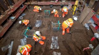 Archaeologists at site