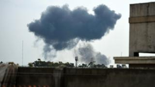 Photo of the crash taken from afar, showing plumes of smoke above the park in Shakarparian