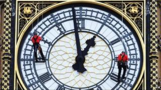 Men abseil down St Stephen's Tower, which houses Big Ben