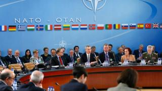 NATO Secretary General Jens Stoltenberg (C) addresses a NATO defence ministers meeting at the alliance's headquarters in Brussels on 10 February 2016