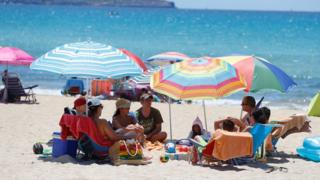 positive people Tourists on a beach in Majorca, 21 Jun 20