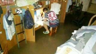 Photo of a Chinese student studying in floodwaters in Wuhan, taken from Weibo