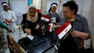 Egyptians cast their votes at a polling station during the presidential election in Cairo, Egypt, March 26, 2018.
