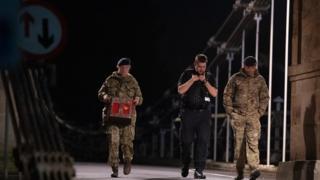 Bomb disposal team retrieving grenade