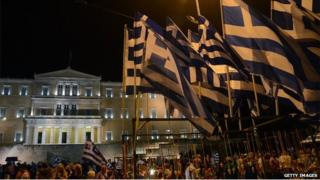 greek flags and demonstrators