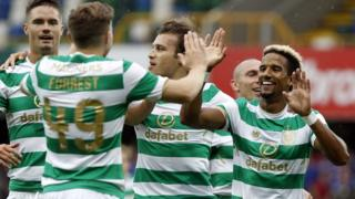Scott Sinclair celebrates with Celtic teammates after scoring against Linfield