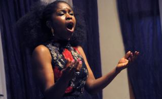 "Nigerian soprano Omo Bello rehearses in Lagos on December 8, 2017. A live performance of an aria from an Italian opera, sung by a professional soprano, isn""t a common sound in Nigeria""s bustling commercial and entertainment capital. But it""s not the strangest thing for the performer, Omo Bello. News of her appearance in Lagos has attracted a crowd, even it""s only for a short rehearsal."