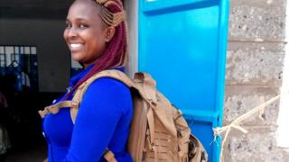 Midwife Margaret Wairimu Maina carries a technology-packed backpack