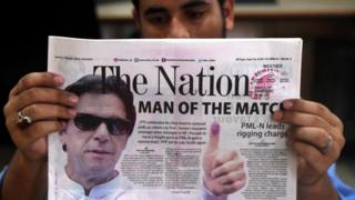 A Pakistani newspaper with a picture of Imran Khan, head of Pakistan Tehrik-e-Insaf (PTI) political party, a day after general elections in Karachi, Pakistan, 26 July 2018