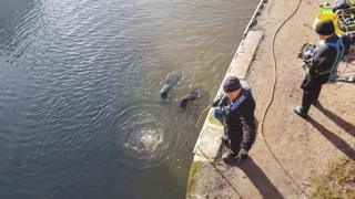 Specialist divers searching the River Soar in Leicester