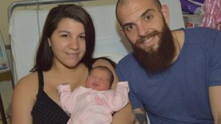 Georgios Sarris with Maria and baby Nancy