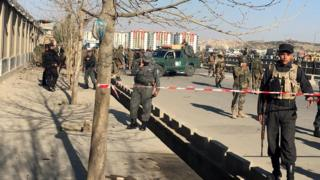 Afghan security officials secure the site of a suicide bomb blast near a defence ministry gate, in Kabul, Afghanistan, 27 February 2016.