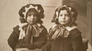Archive photo of children wearing matching outfits